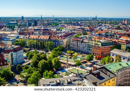 The Viktualienmarkt is a daily food market and a square in the center of Munich, Germany. The Viktualienmarkt developed from an original farmers' market to a popular market for gourmets. - stock photo