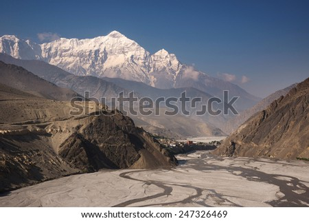 The village of Kagbeni, with Mt. Nilgiri in background, Upper Mustang, Nepal - stock photo