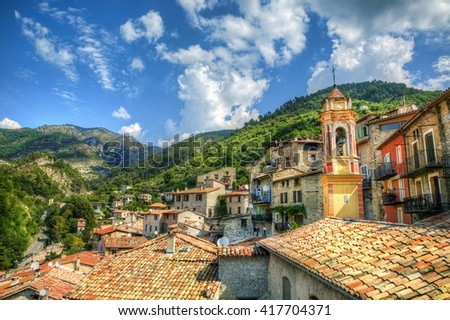 The Village of Luceram with the Bell Tower of Chapelle Saint-Jean, Alpes-Maritimes, Provence, France - stock photo