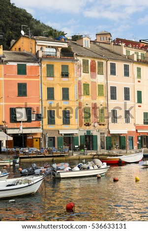 The village of Portofino with boats in the port and the colorful houses. Genova, Liguria, Italy