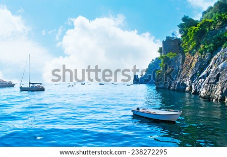The village of Positano is a perfect for boat trips to the neighboring islands and along the rocky shores of Amalfi coast, Italy. - stock photo