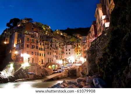 The village of Riomaggiore, one of the five towns in Cinque Terre Italy. - stock photo