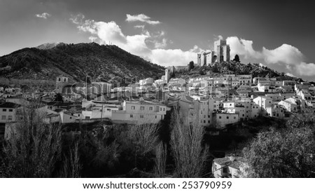 The village of Velez-Blanco in Spain with a beautiful castle in the top of the hill - stock photo
