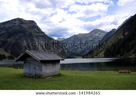 The Vilsalpsee is embedded in the Tannheim mountains in Tyrol, Austria; idyllic location/Mountains and a lake
