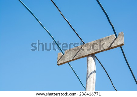 the vintage lectricity wire and wooden pole on blue sky