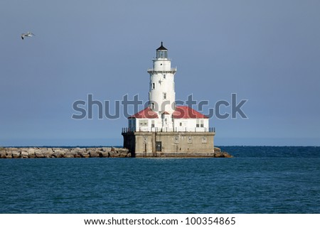 The vintage lighthouse at the entrance to the harbor in Chicago on Lake Michigan - stock photo