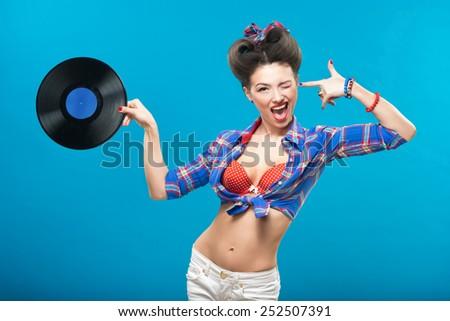 The vintage photo of girl holding vinyl record. - stock photo