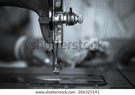 The vintage sewing machine on fashion designer blur background, black and white tone