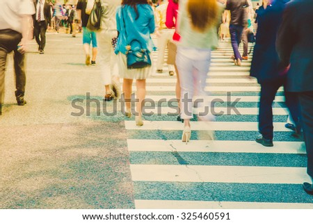 The vintage tone of Blurred photo of Pedestrians in modern city street - stock photo