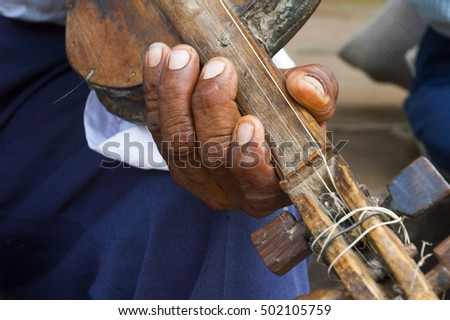 The violin. Close up of men playing the rustic violin