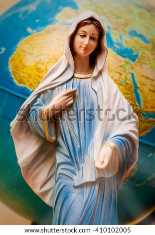 the Virgin Mary in front of Earth  - stock photo