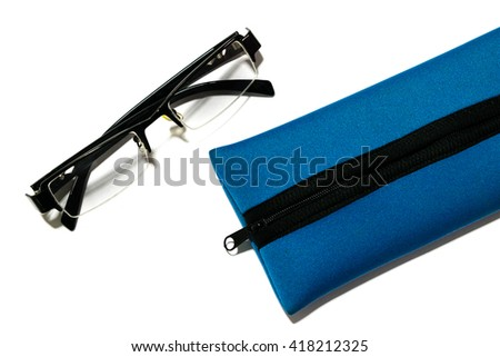 The vivid blue pencil case and glasses; Isolated - stock photo