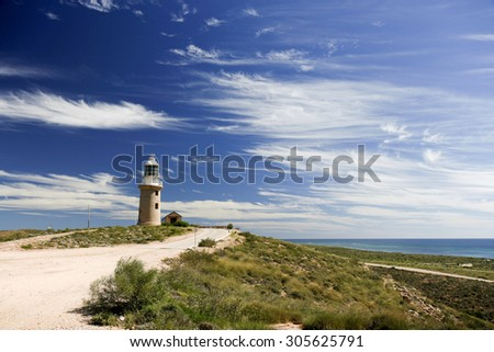 The Vlaming Head Lighthouse in the northernmost tip of the Cape Range in Western Australia was completed in 1912. - stock photo