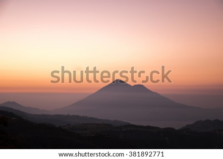 The volcanoes shilouetted against the evening sky. Guatemala - stock photo