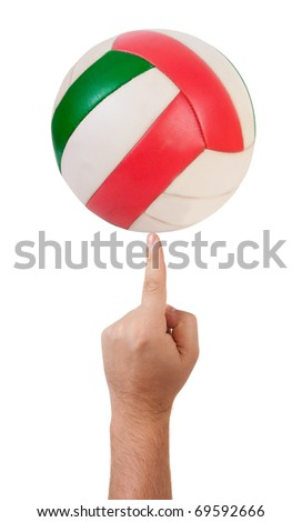 The volleyball ball on finger  isolated over white - stock photo