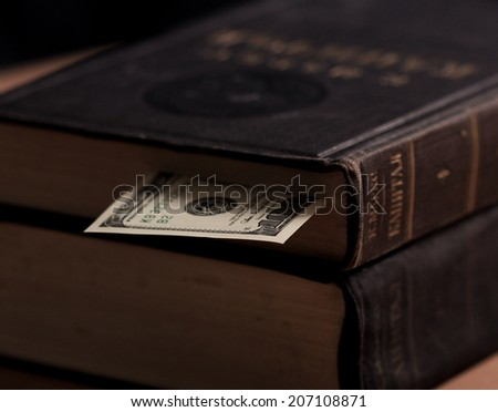 The volume of Capital by Karl Marx with hundred dollars note used as book marker