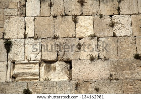 The Wailing Wall in the old city of Jerusalem, one of the most holy places to the Jewish people. - stock photo