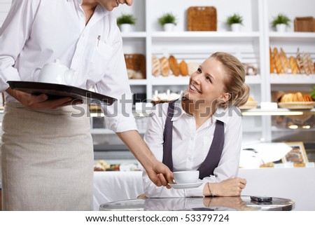 The waiter has brought to the client the order in cafe - stock photo