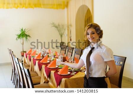 the waiter in the restaurant - stock photo