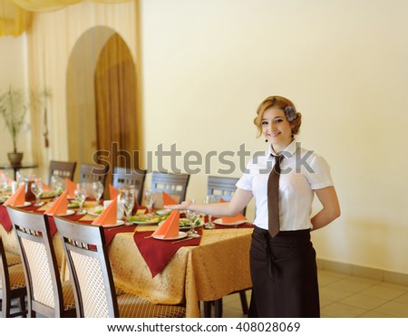 the waiter in the restaurant near served table
