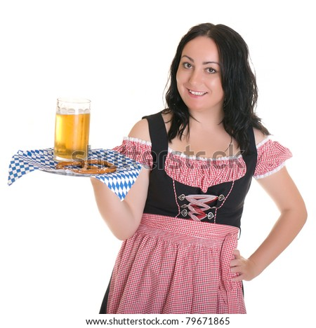 The waitress from Bavaria in the traditional dress has a beer and bretsel.