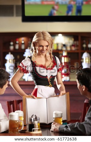 The waitress shows the menu for young men