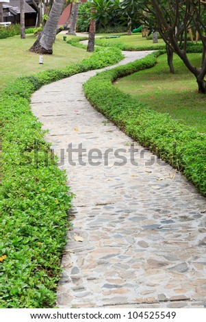 The Walk path in the park with green grass background - stock photo