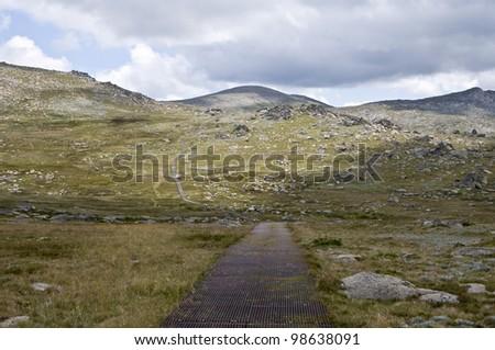 The walking track to Mount Kosciuszko in the Snowy Mountains, New South Wales, Australia. Kosciuszko National Park. - stock photo