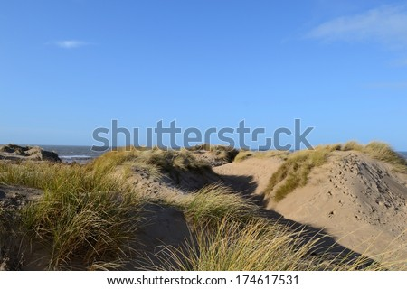 The walkway through the sandy dunes to Formby beach, England. - stock photo