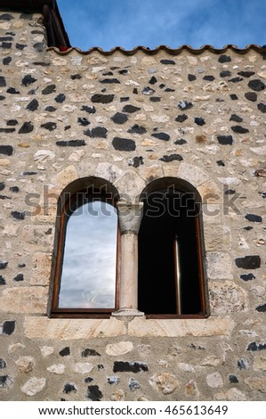 The wall of a medieval building with a window in France