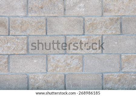 The wall of concrete decorative bricks. textural composition - stock photo