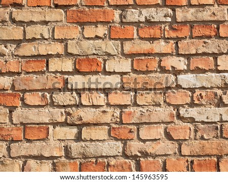 The wall of the deification of the brick, which put a lot of years ago - stock photo