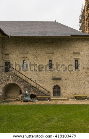 The wall of the fortress, the old bell. Dragomirna monastery, built in 1609 year. Orthodox monastery in the village Mitoku-Dragomirna, Suceava district of in Romania,  Southern Bucovina.