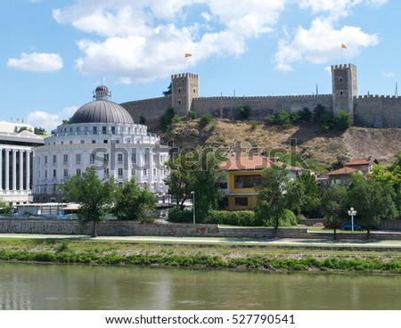 The walls of Kale Fortress over government buildings on the banks of the Vardar River in Skopje