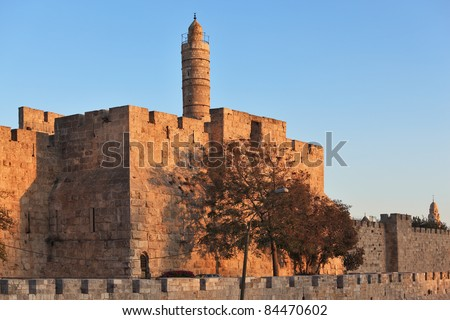 The walls of the eternal Jerusalem. Last rays of the sun gently illuminates the ancient walls and Tower of David - stock photo