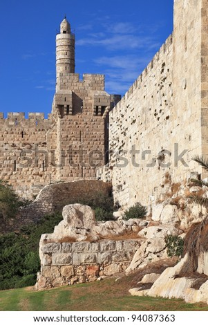 The walls of the eternal Jerusalem. The sunset gently illuminates the ancient walls and Tower of David - stock photo