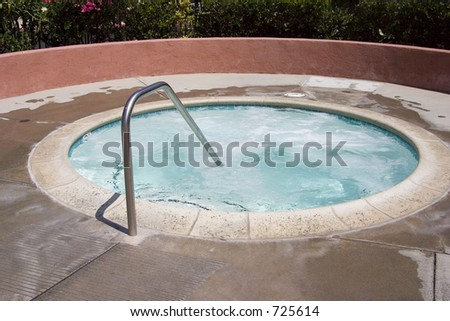 The warm, bubbly, and inviting water of a spa. - stock photo