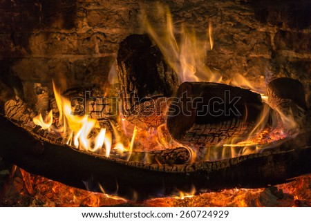 The warmth of a blazing fireside - stock photo