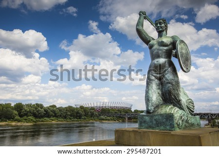 The Warsaw Mermaid called Syrenka on the Vistula River bank in Warsaw, Poland - stock photo