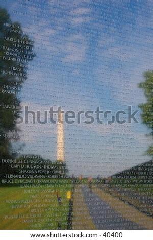 The Washington Monument, reflected in the Vietnam Memorial, Washington, D.C. - stock photo
