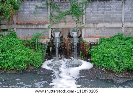 The waste water pipe from the village into the canal. - stock photo