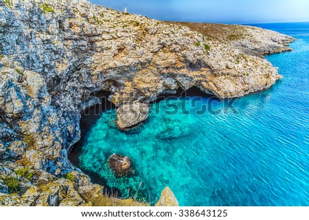 the watch tower of the serpent, symbol of Otranto, on the rocky beach near Otranto in Apulia, Italy - stock photo