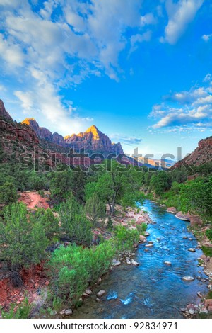 The Watchman at sunrise in Zion Canyon. HDR composition. - stock photo