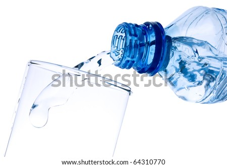 The water flowing in a glass, is photographed in movement - stock photo
