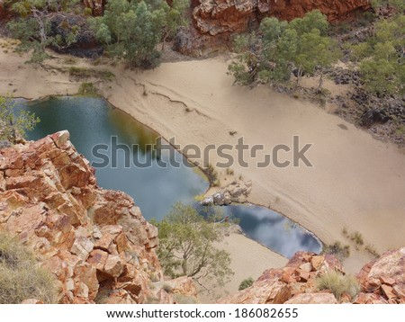 The water hole of Ormiston gorge in the West Mcdonnell ranges in the Northern Territories in Australia - stock photo
