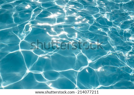 The water surface of a swimming pool during sunny. - stock photo