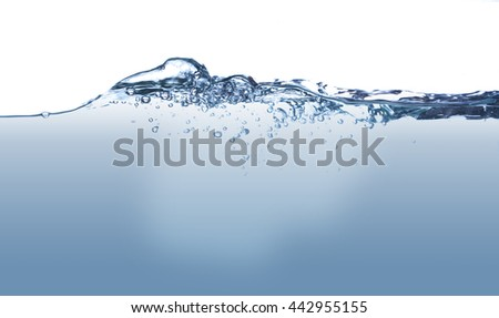 The water surface with underwater bubbles. There is minor ripples on the surface and light rays underwater. The colour is changing from the deep to the top of the surface