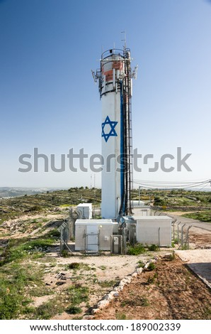 the water tower of the israeli settlement Neve Daniel at the west bank, israel - stock photo