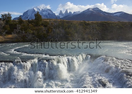 """The waterfall """"Cascada Paine"""" on the River Paine in Torres del Paine National Park in the Magallanes region of southern Chile. - stock photo"""