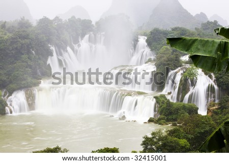 The waterfall in fog - stock photo